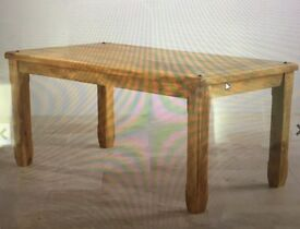 6 month old Baku light solid mango wood dining room table