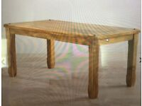 6 month old Baku light solid mango wood dining room table