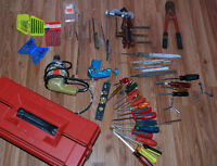Lot of hand tools. Drill. Files. Vice grips. Screwdrivers.