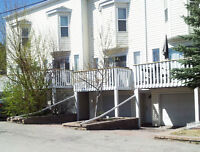 A BARGAIN! 3 Bed Townhome with garage, inner city SW location.