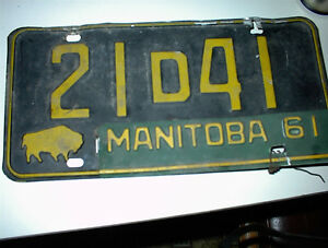 USED PAIR OF 1958 LICENCE PLATES WITH A 1961 TAG $10