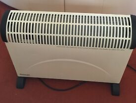 Micromark instant electric heater with thermostat timer and heat control to compact the winter