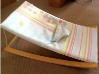 Stylish mothercare fabric and wood rocker