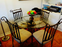 A glass table set with 4 chairs *PERFECT CONDITIONS*