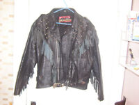 Leather jacket with fringes, fringed and studs.