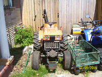 Kubota B6000E tractor with 3 point post hole auger