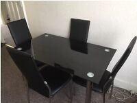 Glass black dining table 4 seater