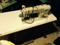 Sewing machine with motor in head. Brother.