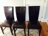 Three faux leather chairs