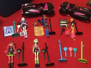 Monster high dolls and cars
