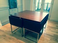 Square dark wooden table and leather chairs