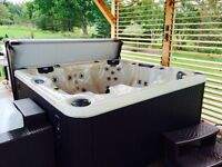 One year old hot tub seats 5 to 6 people with lounger