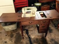 Domestic sewing machine in table