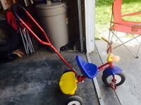 Tricycle with push