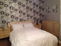 Double bed with side drawers
