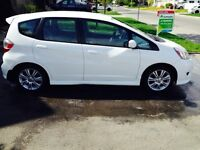 Wow Honda fit. 49000km conditions show rom a-1 une tx a payé
