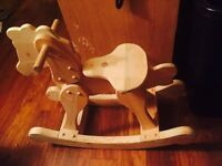 Wooden rocking horse for sale $50. Unfinished pine wood