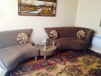 section of two sofa and round table