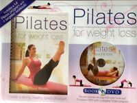 New in box. Pilates DVD and book.