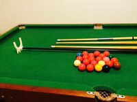 Pool Table With Balls and Cues