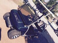 Green golf club car (gas). Reduced