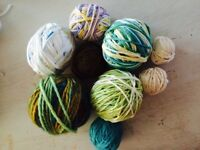 Assorted yarns in greens, beige and white