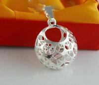 # 120 - Pendentif en forme de boule avec l'emblème Peace and Lov