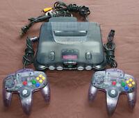 Clear Smoke Grey Nintendo 64 & 2 Atomic Purple Controllers