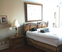 ANTIQUE CHERRY KING BED, NIGHT TABLES AND MIRRORS