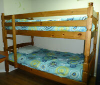 Bunk bed with mattresses and beeding