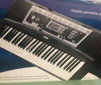 Yamaha keyboard. Like new. With stand. Gfw