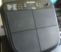 Alesis Percussion Pad with mounting plate.