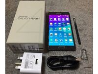 Samsung galaxy Note4 black Locked on EE, Tmobil, Orange and Vergin U.K. networks. Perfect condition!