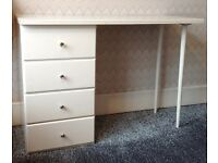 White wooden desk with 3 drawers.