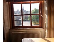 Double room very big size next to abertay university and city Centre....