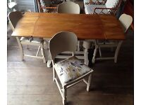 Draw Leaf Extending Dining Table With Four Chairs