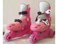 Girl's adjustable tri-skates. Pink. Sizes 9-12.