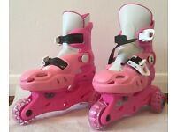 Girl's adjustable tri-skates. Pink. Sizes 9-12.