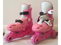Girl's adjustable tri-skates. Pink. Sizes 9-12