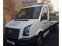 Recovery and Breakdown Service 24/7. Man with recovery truck.