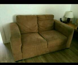 Beige Ikea two seater sofa