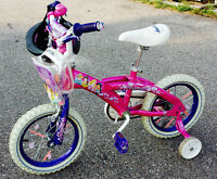 Girl's bicycle with training wheels