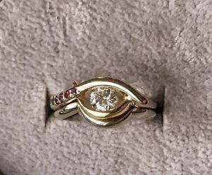 Beautiful .45ct diamond and ruby engagement ring set.