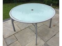 Round glass patio table and cover