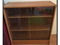 Wooden cabinet with glass sliding doors