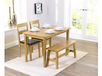 As new condition: Oak dining set with bench and chairs