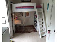 Custom-built kid's bed/desk/bookshelf