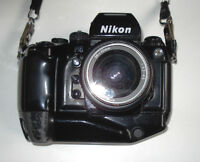 Nikon F4 w. motor drive . pfct condition with handle,zoom 35x70