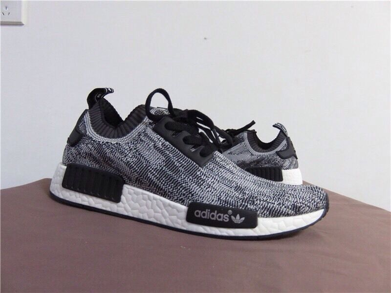 The adidas NMD R1 Glitch Camo Core Black Is Now Available