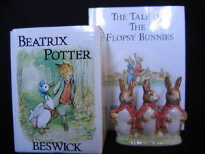 "BESWICK ""FLOPSY, MOPSY AND COTTONTAIL"" FIGURINE AND BOOK."